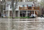 Photo of flood waters rising on a home