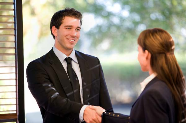 Photo of a Louisville real estate agent shaking hands with his client