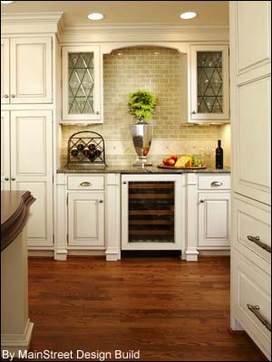 Photo of a wine cooler designed to seemlessly fit with the kitchen cabinet design