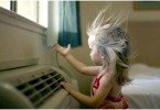 Photo of a young girl in front of an AC unit