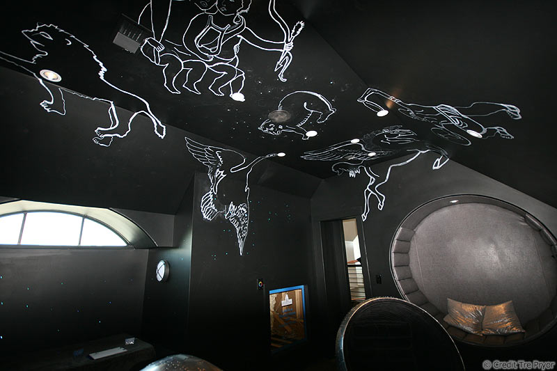 Photo of ceilings constellations painted with fluorescent paint by Tre Pryor