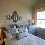 Photo of bedroom with shiplap style walls in Homearama 2016 by Tre Pryor
