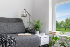 Photo of room with modern decor and beautiful view over green garden