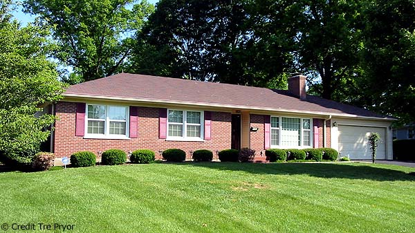 Photo of a home with winning landscaping, Ideal Home Improvements