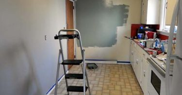 Photo of kitchen getting painted