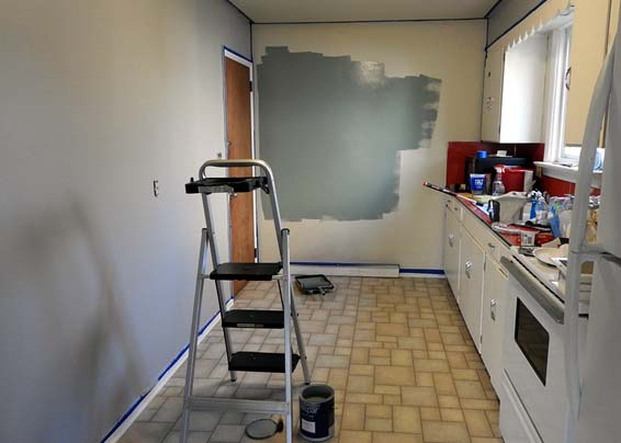Photo of kitchen getting painted is just one of several home improvement tips in this article