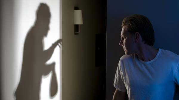 Photo of burglar taking valuables - Protect your new home