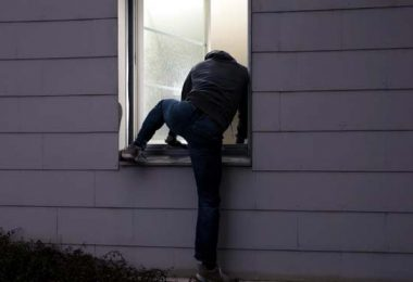 Photo of burglar coming in a window - Protect your new home