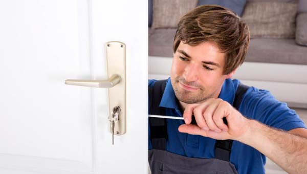 Photo of locksmith changing the locks: Make Your House a Home