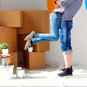 Photo of couple hugging as they move in their new home