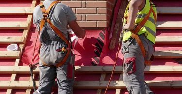 Photo of two roofing contractors