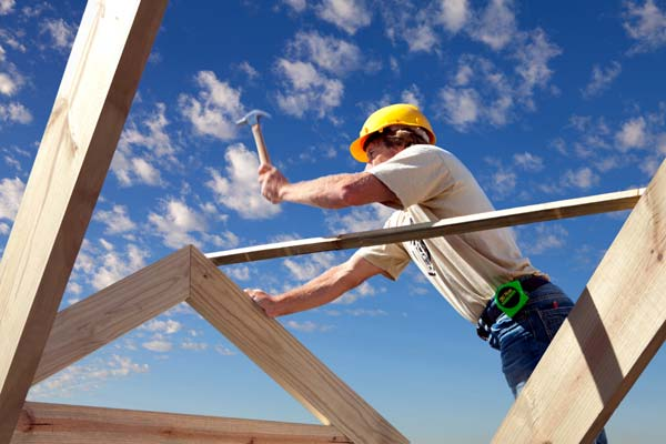 Photo of a roofer installing a new roof