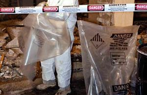 Photo of an asbestos abatement worker.