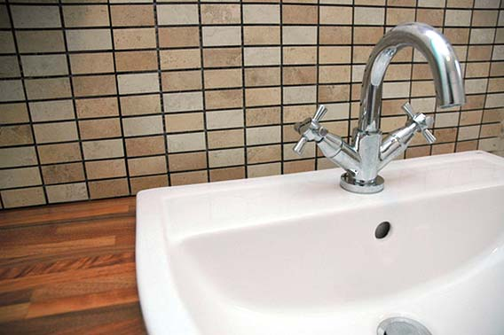Photo of a bathroom sink and faucet - Checking Your Home's Health