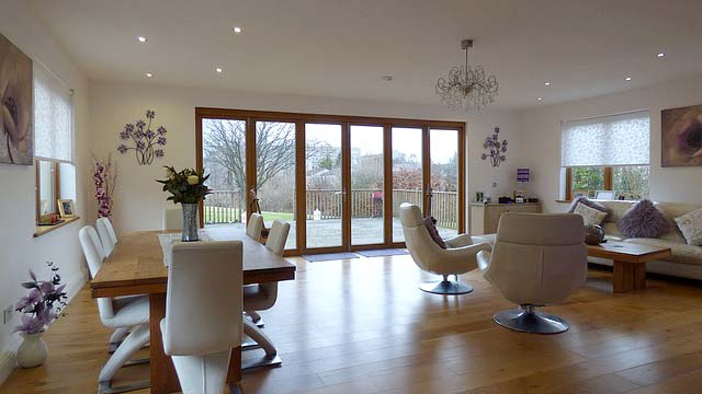 Photo of open floorplan with folding doors - New Trends for Residential Home Design