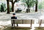 Photo of an older man on a park bench