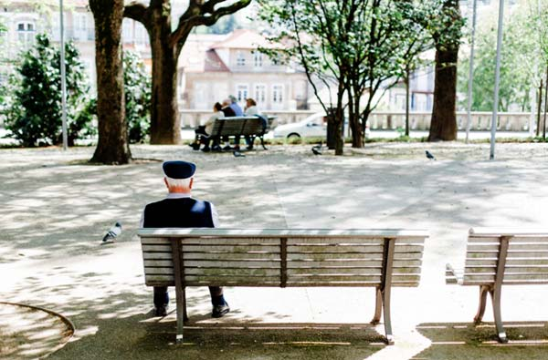 Photo of an older man on a park bench- Advice for Keeping Your Parents at Home