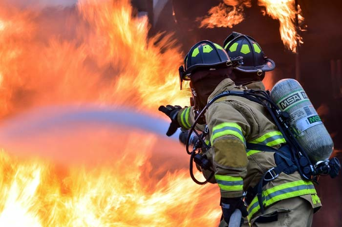 Photo of firemen working a house fire.