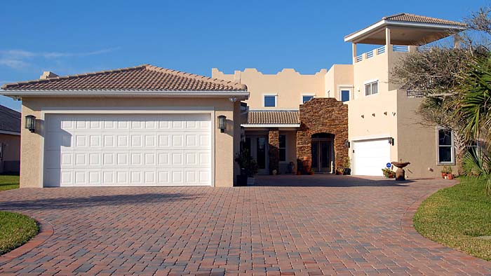 Photo of an interlocking stone driveway - Ideas On How To Maintain Your Interlocking Stone Driveway