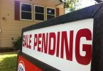 Photo of a real estate sign with sale pending