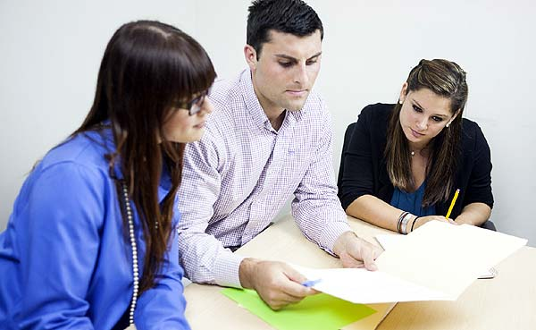 Photo of some people doing paperwork - Rentals: What are tenants responsible for?